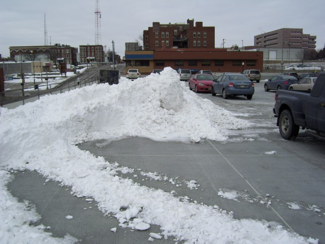 Plowed snow in parking lot
