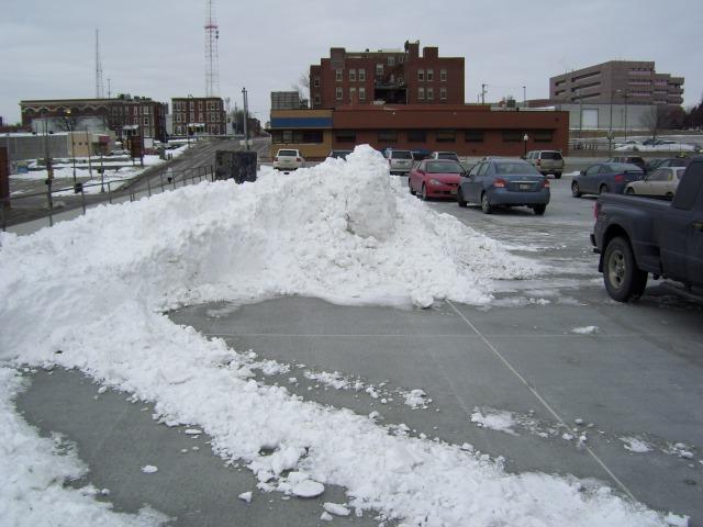 Plowed snow in parking lot